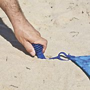 Sand away beach blanket. One step ahead