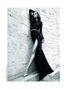 High fashion photography, editorial, glam pose. Love the location and use of angles of the model.