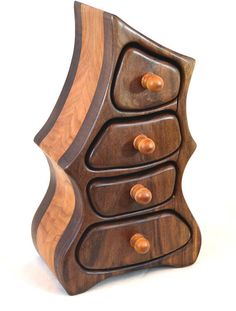 """A fun box that is reminiscent of furniture in the Beauty & the Beast or old Disney wizards. It has four drawers, stands 10.5"""" tall, 6.5"""" wide & 3.75"""" deep Made with walnut & cherry."""