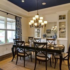 <3 navy, beige and white...  Plus shades over table, long curtains and built-ins for storage