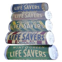 Set of 5 Giant Figural Lifesaver Candies Signs 1930s - These signs hung in the original headquarters based in Port Chester N.Y. They date around the mid 30's . They are paint , lithography and foil. on solid 1/2 inch board.