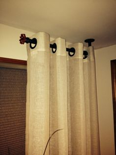 Pipe curtain rod with turn-off valve for finial