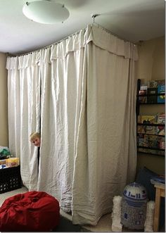 Never have to make the bed again. ikea curtains and rod -- no sew