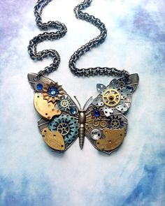 Steampunk Butterfly Necklace - Silver Butterfly with Watch Gears Brass Flowers and Jewels in Royal and Light Blue. $106.00, via Etsy.