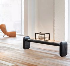 Charles de Lisle Judo Bench, 2013. Carved with a chainsaw. Shown with a Bruno Romeda Tabouret and a Marc Newson Wicker Chair.