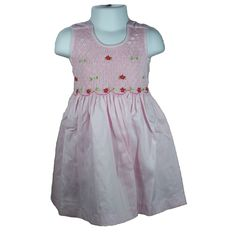"""Freya (Pink) - Traditional smocked dress with embroidery overlay.  Sleeveless style.  Button fastening of the straps and back, with matching fabric """"ribbons"""" to tie a bow. Available in sizes 1-8 years."""