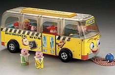 In 1950, three Fisher-Price toymakers designed a toy fire truck, fixing three round-headed firefighters on top. Nine years later, the company produced the Safety School Bus with removable figures—samestumpy,roucharactersas before.