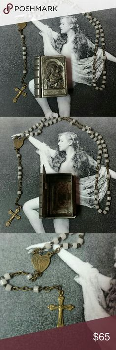 """Vintage Czech milk glass rosary and tin case Vintage Czech milk glass rosary with brass findings with silvertone tin rosary case depicting the Virgin Mary and Baby Jesus. Stamped Czechoslovakia on the back. Patina exists due to age. From 20's or 30's. Part of my great aunt's estate.  Excellent vintage condition due to age.  Case measures 1.5"""" tall and 1.25"""" wide. Just under .5"""" thick. Closes securely.  Rosary is 11"""" in length.  Reasonable offers welcome and accepted :) Vintage Jewelry"""
