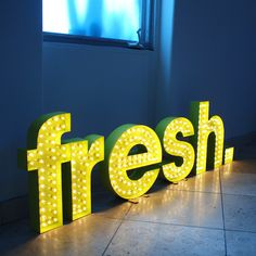 We love bold businesses with bright ideas. Literally. Neon office sign at L.A. design/development company Fresh Interactive (www.freshiscool.com)
