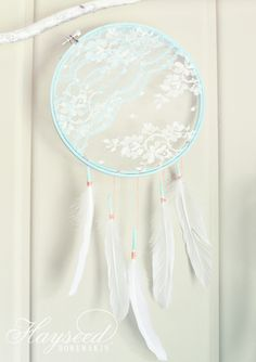 I love this lace dream catcher. All you do is put lace in the middle of a painted embroidery hoop, and...glue the feathers on the bottom? I'm guessing