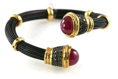 Sterling silver elephant hair bracelet with cabochon rubies.