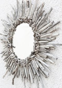 DIY Driftwood Sunburst Mirror    Wooden base from Home-Depot (17inches) 16.99  Mirror from Michael's (14inch) 7.99  Finish nails/ nail gun  Two inch section routed around base  Mirror glue from Home-Depot (liquid nails)  Mounting bracket's in back of mirror