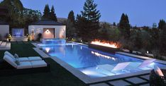 This landscape renovation was coordinated concurrently with the extensive architectural remodel of the home. The intent was a complete transformation of the outdoor areas to create a dramatic and welcoming yard that both comforts the… Swimming Pool Landscaping, Luxury Swimming Pools, Luxury Pools, Dream Pools, Swimming Pool Designs, Backyard Pool Designs, Small Backyard Pools, Backyard Patio, Outdoor Pool