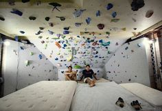 They are named Cliff and Kyle and this is the Monkey Cave. The Monkey Cave is a home rock climbing gym that the two guys built under Cliff's house.