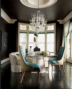 Dining room painted in Sherwin-Williams Iron Ore - this room looks like it's been painted black but has a tone of brown to it