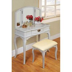 This 3-piece vanity set is a great addition to your bedroom or bathroom to create personal space. This vanity set features white finish, table with drawer, tri-folding mirror and coordinating stool.