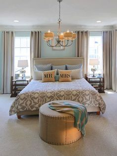 Traditionally found in dining rooms, elegant chandeliers with shades are making their way into new spaces. Refresh your master bedroom design with a classic chandelier above the bed | Credit: Miller & Smith Homes, Jim Kirby Photography