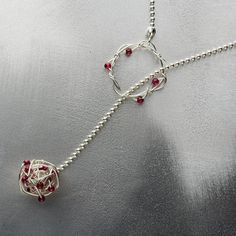 Kathy Frey necklace.... makes me think of shooting hoops...