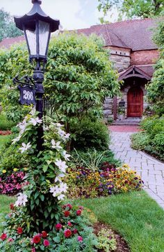 I like the idea of a light pole with the street number. Front yard landscape design