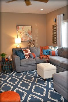 ORANGE ACCENTS LIVING ROOM | Orange and Blue Living Room. Colorful pillows are my favorite!