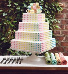 Candy Button cake :) Id go faux cake on this one tho. Ill be hiding a cheap sheet cake in back to cut up haha.