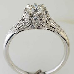 """This piece is our """"Crowning Glory"""" ring from our Scream Collection.  I admit to being somewhat biased, but I think our bench did an incredible job on this ring."""