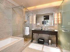 Fixtures to the side of the mirror provide just the right lighting for your morning routine.