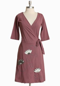Blooming Lotus Wrap Dress By Synergy 74.99 at shopruche.com. Designed in organic cotton, this soft wrap dress in dusty lavender features a flattering silhoutte with a stitched floral design.  100% Organic Cotton, Imported , 37.5'' long from shoulder