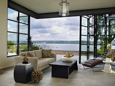 Book House on Lake Washington....love how this living space opens to the outside and what a great view!