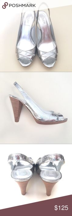 J. Crew Colette Mirror Slingbacks NWOT J. Crew Colette Mirror slingbacks. Size 8, 4in heel including a .5in platform. Bright shiny silver with a light brown heel, peep toe style. Style# 21746. Absolutely gorgeous and comfortable. These are in PRISTINE condition. New without tags, these have never been worn, only tried on. Sold out! Retail at $225. No box. J. Crew Shoes Heels