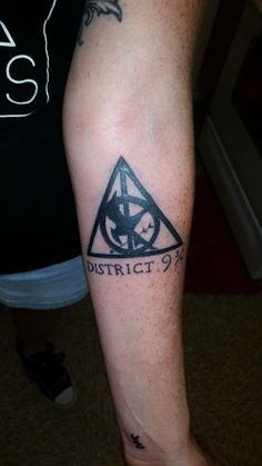 My Geek Ink. Deathly Mockingjay tattoo, District 9 3/4. Harry Potter and The Hunger Games FTW!
