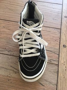 "0a44407988 Vans Maddie Zip-Up High-Top Sneakers. Look like ""Old Skool"" model but zip  in the back instead (no need to tie shoe laces)."