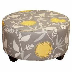 """Bring floral flair to your home with this garden-chic cocktail ottoman, featuring a pine wood frame and refreshing color palette. Handmade in the USA.   Product: OttomanConstruction Material: Pine wood, polyurethane and polyester fillColor: Polly doveFeatures: Handmade in the USADimensions: 18"""" H x 31"""" Diameter Note: Easy assembly requiredCleaning and Care: Spot clean only"""