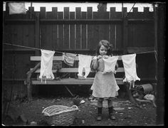 Washday with dolls clothes, Mary pegging them on a miniature washing line c1907 © National Museums Liverpool (by kind permission of Heather Price)