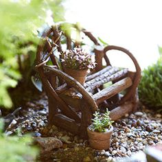 Easy accessories: Craft an arbor from twigs and raffia, or a garden grotto from pieces of bark. A small mirror makes a good reflecting pool. Aquarium gravel can be used as a garden path.