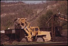 Coal Loader near Chattaroy in the Southwestern Part of West Virginia, near Williamson. This Type of Machine Is Used to Move Coal and in Cleanup Operations 04/1974 | by The U.S. National Archives