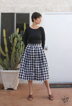 The pleated skirt is one of my all time favorite things to make. It's basically just a rectangle with lots of folds (aka pleats) attached to a waistband. I've shared a tutorial for making a pleated skirt before but I thought I would take it one step farther and show you how to make one with a button