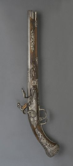 Flintlock Pistol -   Locks made by Diomede Adventi, Italian (active Brescia), c. 1680 - c. 1730. Barrel made by Lazarino Cominazzo III, Italian (Brescia), died 1696. Date: c. 1685.