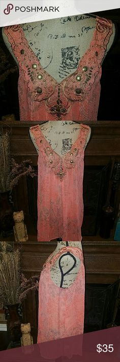 SNAKE PRINT TOP WITH GORGEOUS DETAILING This top is absolutely gorgeous with beautiful detailing all over the bodice. This is a gorgeous Coral snake print top that has brushed bronze beading and a gorgeous design on the front and back. It is so pretty. It is a little sheer. Material is 100% polyester. Brand new with tags. Sienna Rose Inc Tops