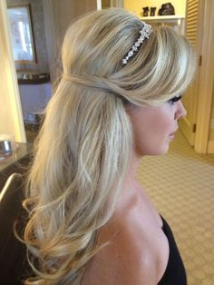 I like the idea of a half-up hairstyle with some sort of hairband or sleeping beauty style ribbon