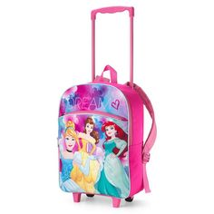 "A Disney princess rolling backpack.Polyester and plastic, imported, 16"" x 12"" x 5"", ages 5 and up. - Pink handle that can be pushed down to store or pulled up to use to pull.- Pink backback with pink handle and shoulder straps.- Bottom of backpack: two legs in front and two wheels in back.- Picture of Cinderalla, Ariel, and Bella on front with the words ""DREAM"" above them.- Zipper pocket in front.- Zipper closure for backpack. ©Disney"