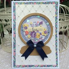 Folk Floral shaker card | docrafts.com card made using Marianne Designs snowglobe die, Docrafts Folk Floral range and Coutute Creations Tied Together embossing folder