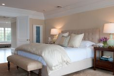 Neutral master bedroom by Nightingale Design.