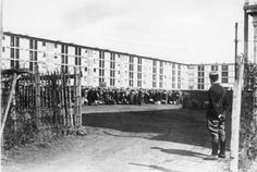France, Drancy (?) .- Sammellager / Durchgangslager.- arrested Jews in the detention camp, French policeman standing at gate
