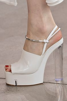 White patent platforms with metal bracelet details from the Spring 2014 Calvin Klein Collection.