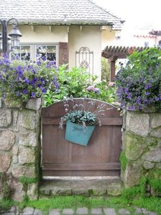 country-style gate with basket of flowers