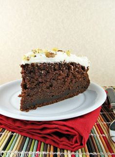 Chocolate Zucchini Cake with Sour Cream Frosting by Cinnamon Spice and Everything Nice