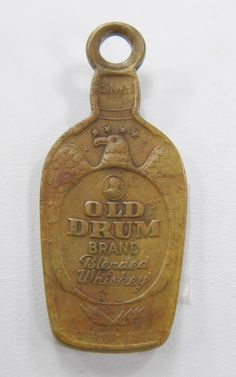 Old Drum Blended Whiskey Brass Bottle Shaped Lucky Charm Piece Calvert - NYC - Vintage 13889 by QueeniesCollectibles on Etsy