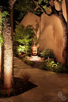 Play with light. Here is another example of how light can create emphasis. Spotlighting and uplighting add glowing washes along the tree trunk and on the face of a sculpture. Garden lighting creates a magical effect that gives the garden a point of view after dark. It may take only one or two fixtures to achieve this effect. asian landscape by Viewpoint Lighting