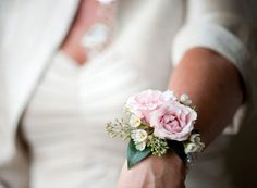 This may be a pretty wrist corsage for the moms - maybe with white flowers instead of the light pink